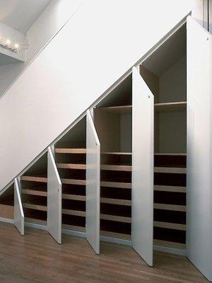 Полки под лестницей в частном доме